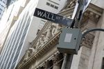 A Wall Street sign is displayed outside the New York Stock Exchange (NYSE) in New York, U.S.