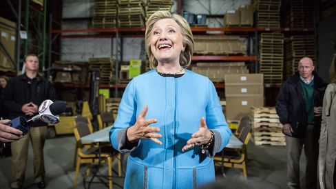 Democratic presidential hopeful and former U.S. Sectetary of State Hillary Clinton speaks with members of the media after a round trable discussion with employees of Whitney Brothers, an educational furniture manufacturer, April 20, 2015 in Keene, New Hampshire.