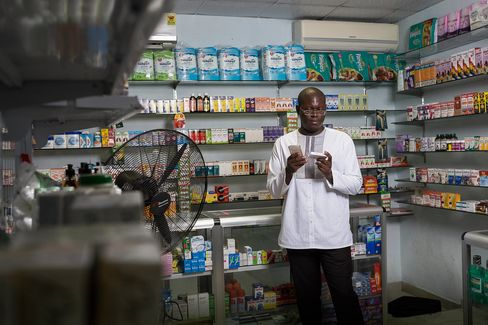 Simons at a pharmacy on Drug Lane in Accra, Ghana.