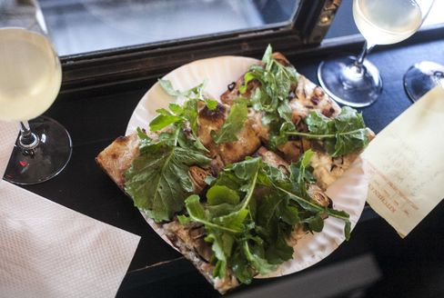 The terrific white pizza was slathered with crème fraîche and topped with arugula leaves.