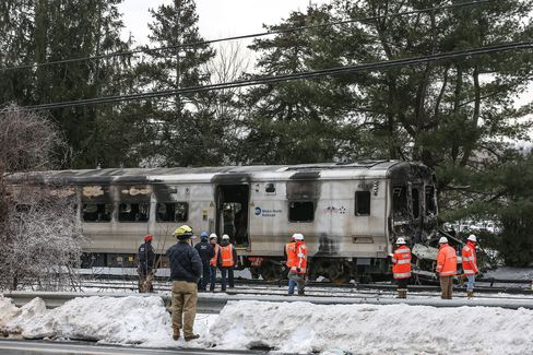Officials inspect a Metro-North train crash with a sport utility vehicle that occurred last night on February 4, 2015 in Valhalla, New York.
