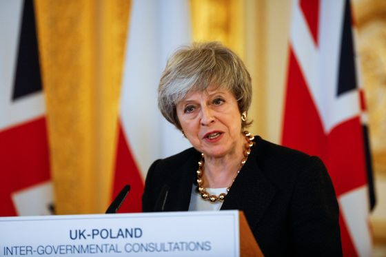 May Fights for Brexit Deal, Warns of Second Referendum Risk
