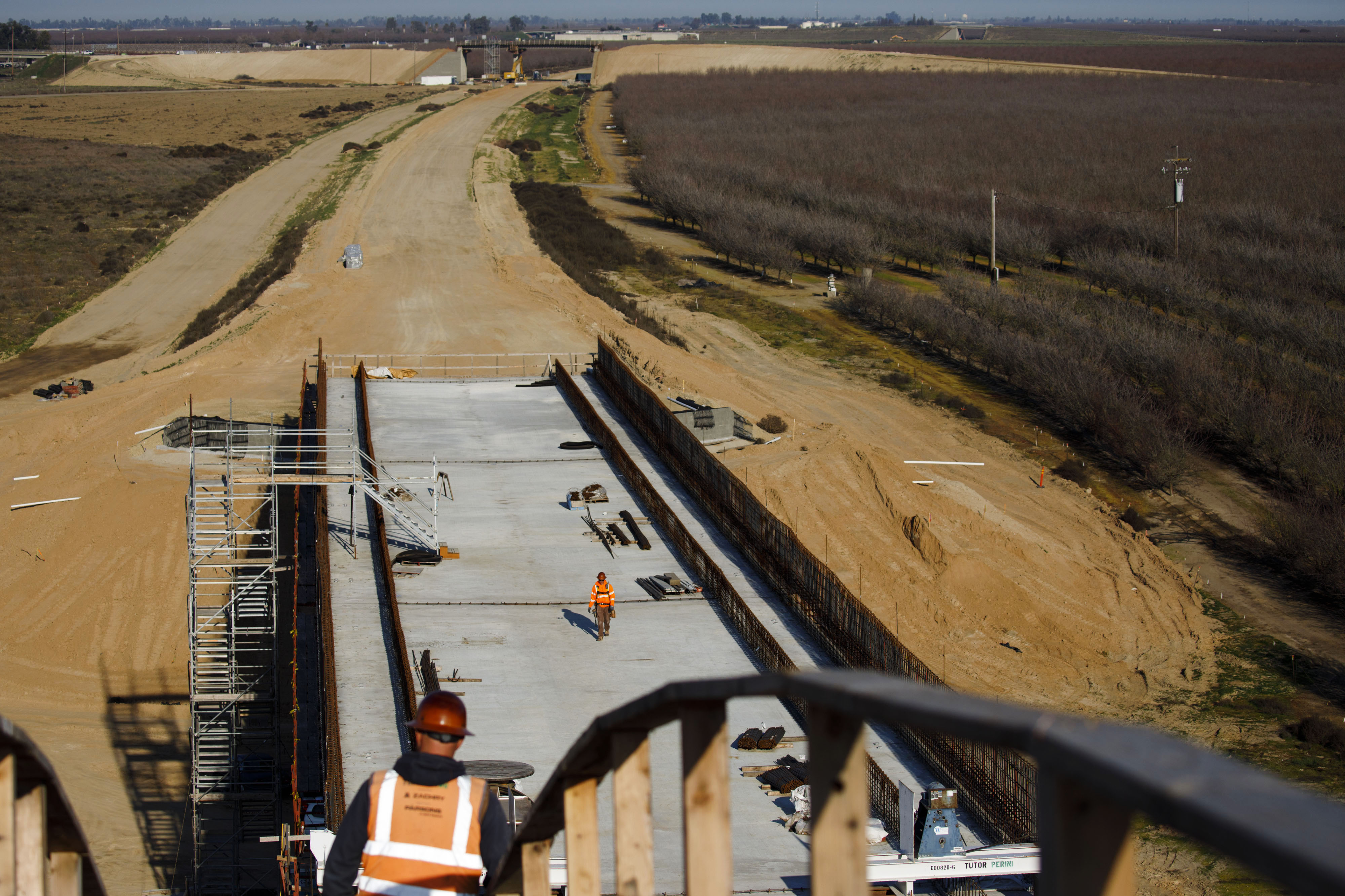 Contractors work during construction on the San Joaquin River viaduct section of a high-speed rail project in Madera, California on Feb. 13, 2020.