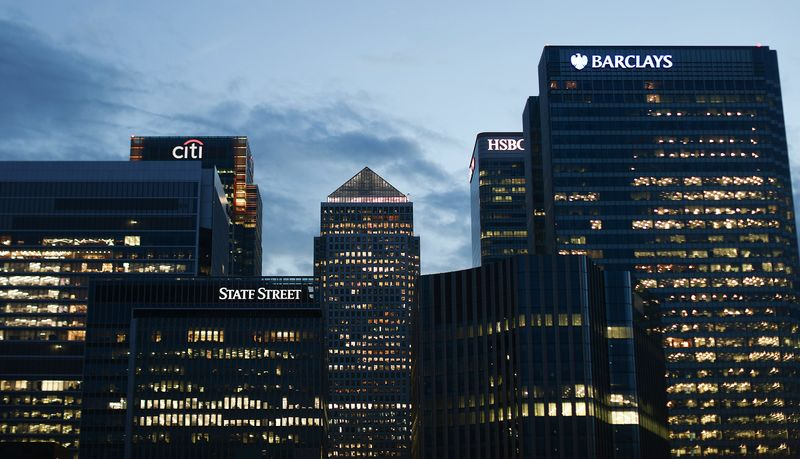 The No. 1 Canada Square skyscraper, center, stands surrounded by office buildings, in the Canary Wharf financial, shopping and business district at dusk in London, U.K., on Tuesday, June 21, 2016. Financial and related services accounted for 11.8 percent of U.K. economic output, or 190 billion pounds ($278 billion), in 2014, and quitting the EU could cost as many as 100,000 jobs in the sector by 2020, according to industry group TheCityUK. Photographer: Simon Dawson/Bloomberg