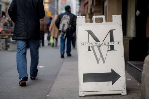 Pedestrians Pass a Men's Wearhouse Inc. Store in New York