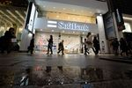 Pedestrians walk past a SoftBank Group Corp. store in Tokyo, Japan,.