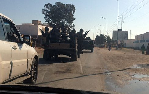 Tunisian security forces patrol streets of Ben Guerdane after March 7 clashes with Islamic State militants.
