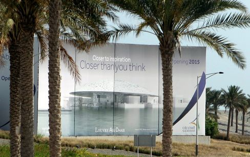 A giant billboard announces the 2015 opening of the Abu Dhabi branch of the Louvre construction site in Abu Dhabi, 2013.