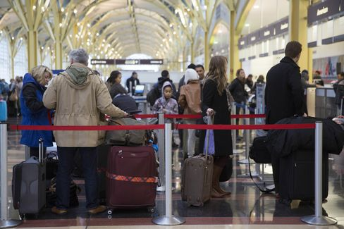 Passengers Wait to Check In at Ronald Reagan National Airport