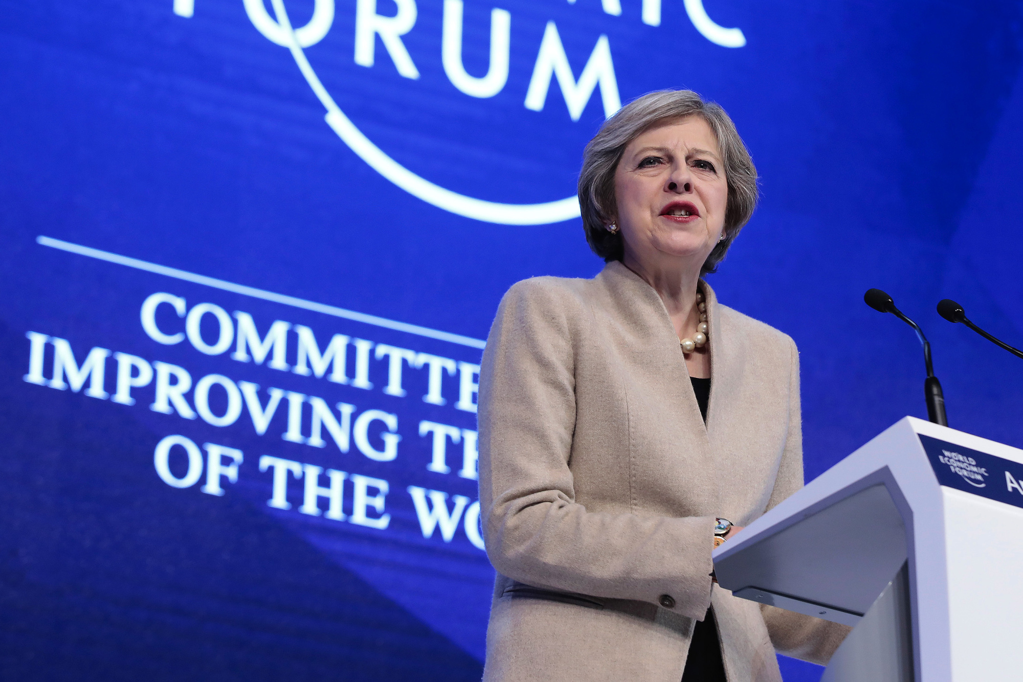 Wall Street Meets May in Davos as Banks Plan Own Brexit