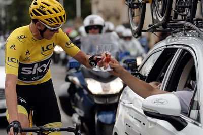 Great Britain's Christopher Froome wearing the overall leader's yellow jersey toats with champagne as he takes the start of the 103 km twenty-first and last stage of the 104th edition of the Tour de France cycling race on July 23, 2017  between Montgeron and Paris Champs-Elysees. / AFP PHOTO / POOL / BENOIT TESSIER        (Photo credit should read BENOIT TESSIER/AFP/Getty Images)