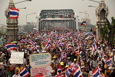 Thais Clash While the Factories Keep Humming