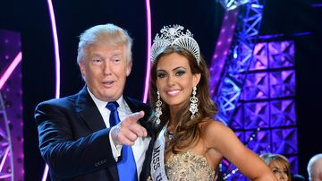 Donald Trump (L) and Miss Connecticut USA Erin Brady pose onstage after Brady won the 2013 Miss USA pageant at PH Live at Planet Hollywood Resort & Casino on June 16, 2013 in Las Vegas, Nevada.
