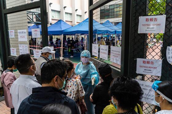 Hong Kong Tightens Gatherings, Sends Civil Servants Home