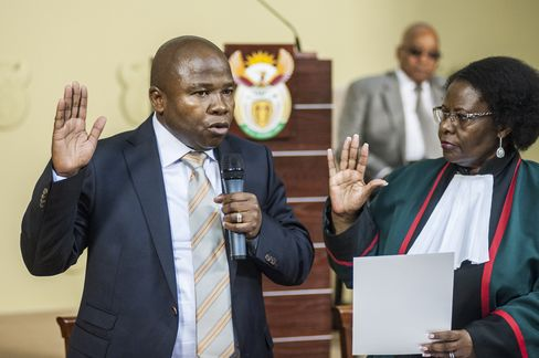 Zuma, center, watches van Rooyen being sworn into office on Dec. 10, 2015.