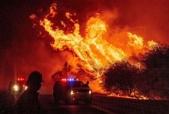 Flames and Smoke Sweep Across U.S. West While Blackouts Ebb