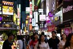 Pedestrians in the Myeongdong shopping district of Seoul, South Korea.