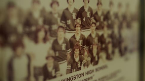 New Jersey Governor Chris Christie is seen in a photo of the 1980 Livingston High School baseball team displayed in the gym at Livingston High School on June 30, 2015.