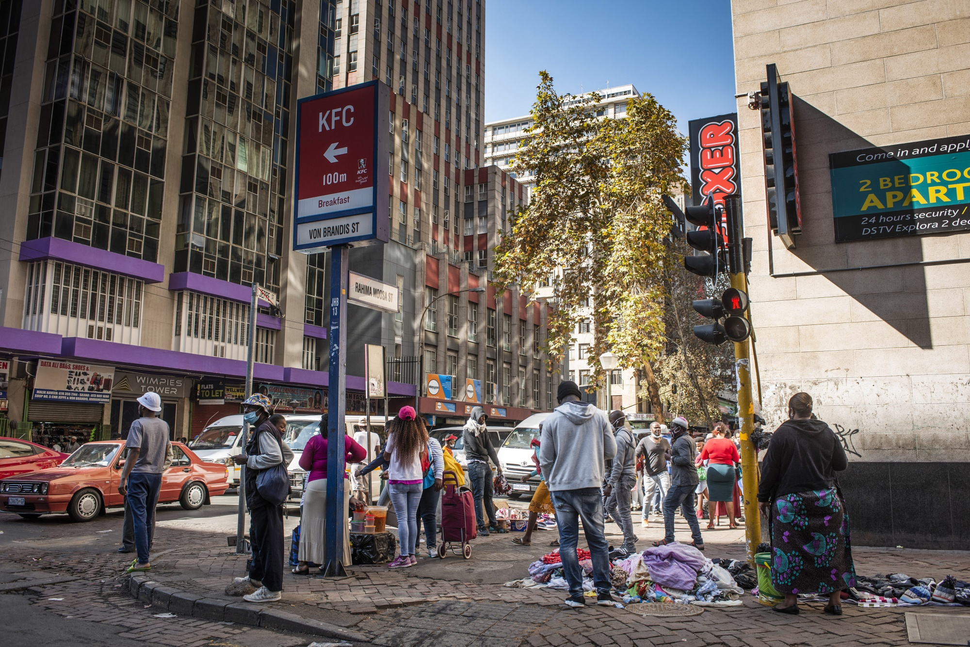 People gather on a street corner in the Central Business District (CBD) of Johannesburg.