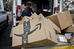 An Amazon.com Inc. package sits in a bin before being placed on a delivery vehicle at the United States Postal Service (USPS) Joseph Curseen Jr. and Thomas Morris Jr. processing and distribution center.