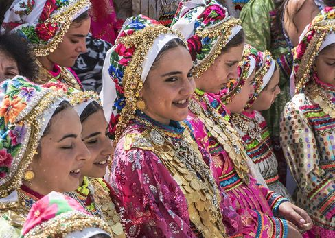 Girls wearing gold coin necklaces on Assumption Day in Olympos.
