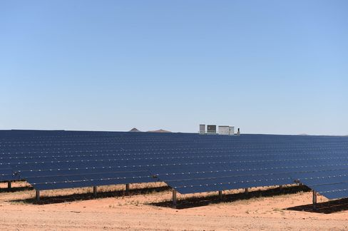 Power conversion stations are positioned at regular intervals within the rows of solar panels at the AGL solar farm.