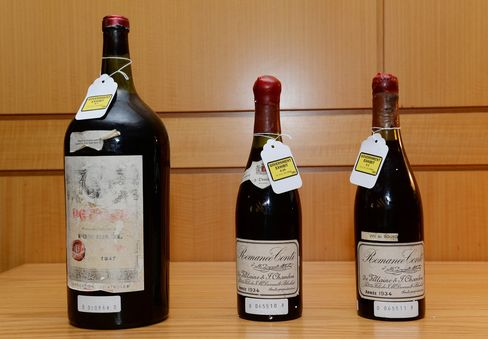 Three wine bottles used as evidence in Kurniawan's trial on display in federal court.