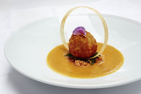 A tofu kofta, or meatball, is delicious with curried bottle gourd.