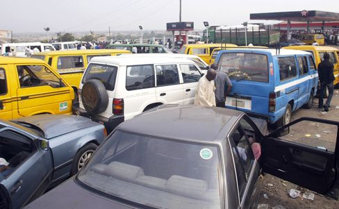 Vehicles queue for fuel at a Texaco fill
