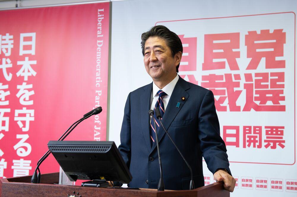 自民総裁選:安倍首相が連続3選、内閣改造へ - Bloomberg