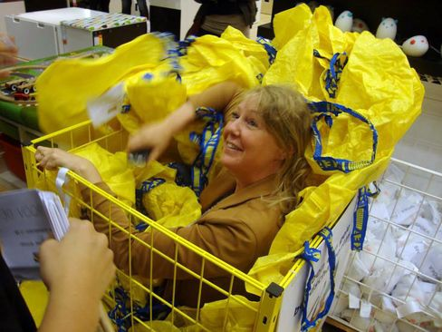 A woman takes part in a game of hide-and-seek at an IKEA store in Wilrijk, Belgium.