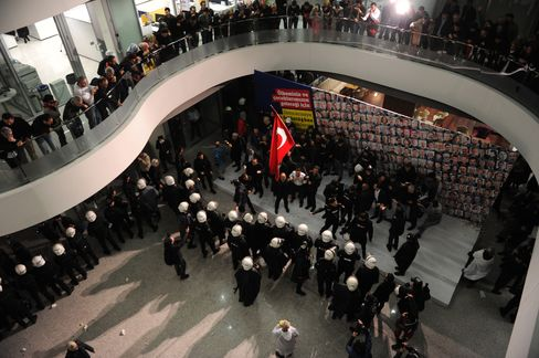 Turkish anti riot police enter the Zaman Daily headquarters in Istanbul on March 5.