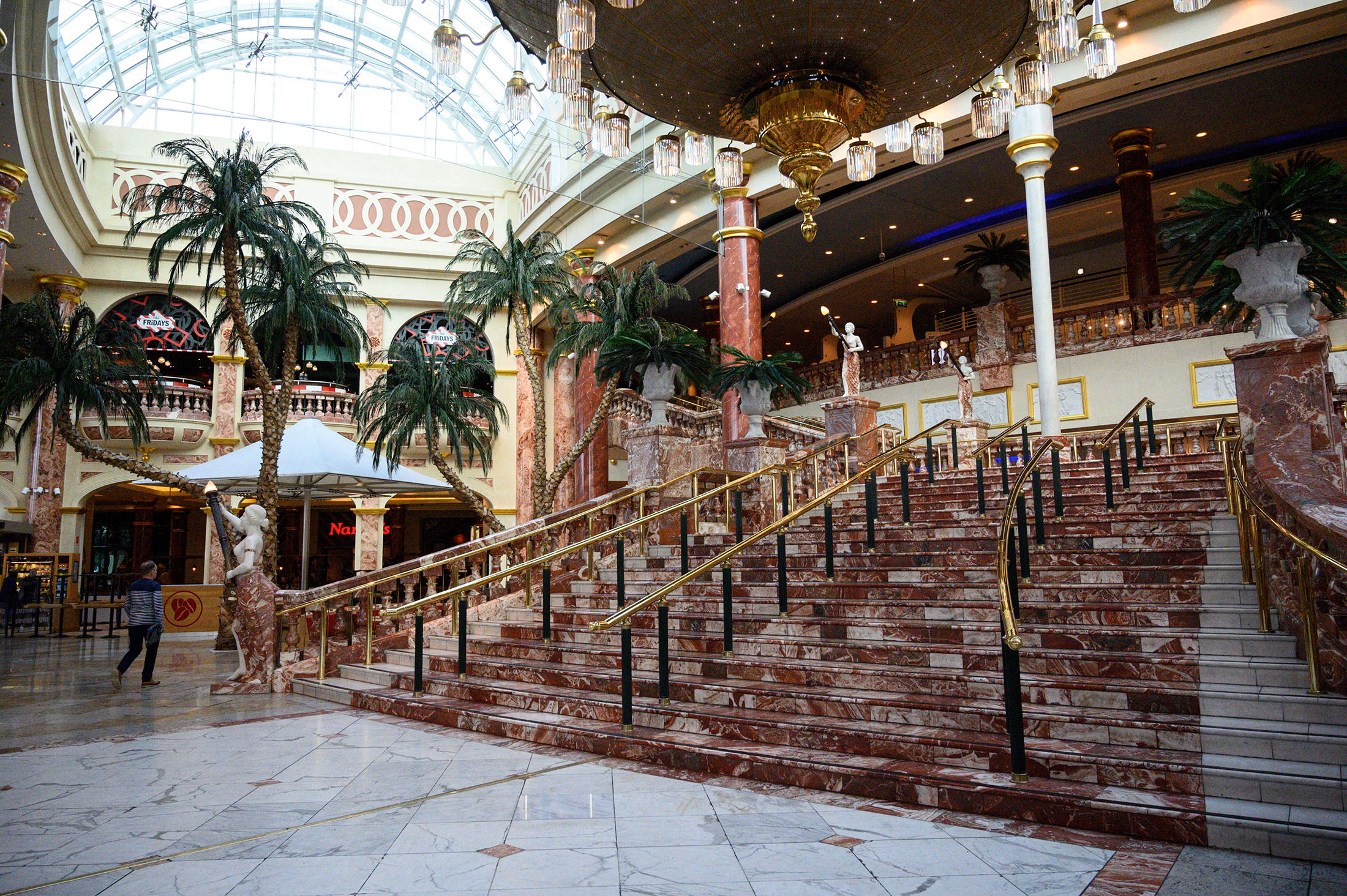 A shopper walks through a near-deserted Intu Trafford Centre shopping mall in Manchester, England, on March 20.