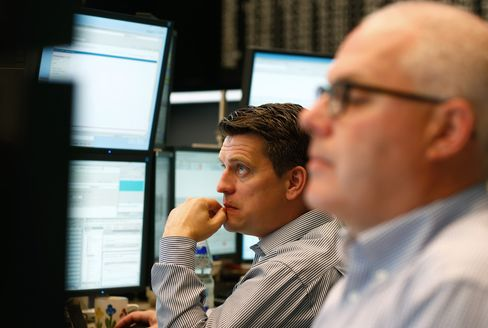 Traders Monitor Data at the Frankfurt Stock Exchange