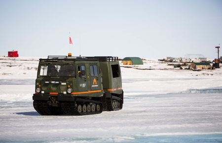 An all-terrain carrier Hagglunds transports workers at Kennady Diamonds' Kelvin Camp.