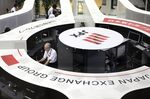 Employees work on the trading floor at the Tokyo Stock Exchange (TSE), operated by Japan Exchange Group Inc. (JPX).