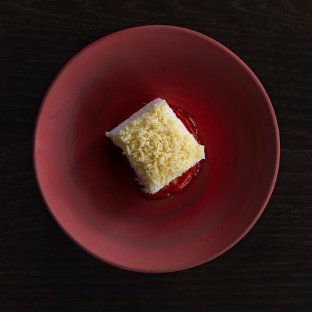 A rum lamington with grated milk and tamarind.
