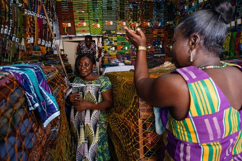 Bolts of GTP cloth, made by the Dutch luxury fabric company Vlisco, shown in a store owned by Perpetual Owusu-Agyemang. She's seen counterfeit versions selling for a fraction of the wholesale price, just down the road.