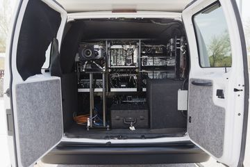 The Pavement Management van contains two external cameras aimed at the pavement and two internal cameras that record a street level view. These cameras record data directly to hard drives custom fitted into the back of the van.