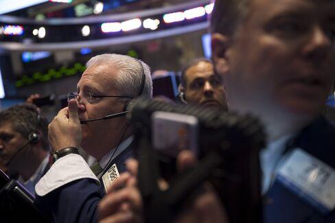 U.S. Stocks, Bonds Climb as Fed Officials Meet Amid Home Sales