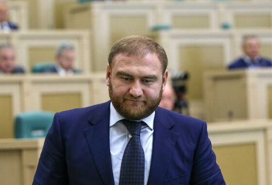 Bust on Senate Floor as Russia Legislator Faces Murder Case