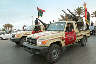 May 2012: Well-armed militias still roam Tripoli's streets - and occasionally clash