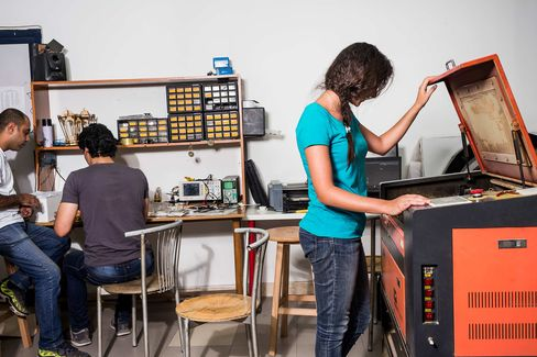 Members of Fab Lab Egypt use a laser cutter on May 18 in Cairo.