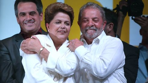 Brazilian President and Workers' Party (PT) candidate Dilma Rousseff (C) celebrates with Brazil's former president Luiz Inacio Lula Da Silva (R) after being re-elected on October 26, 2014 in Brasilia, Brazil.