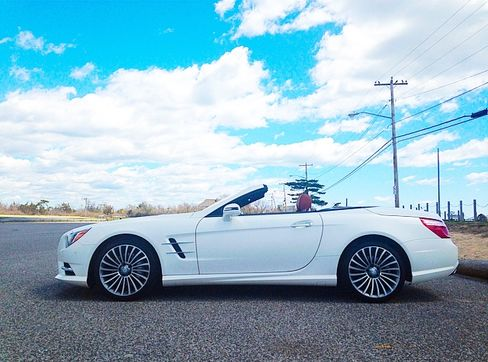 The SL400 is the modern embodiment of the SL300 Mercedes that was made 60 years ago.