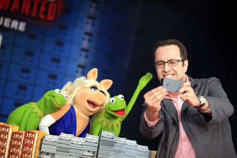 Subway spokesman Jared Fogle arrive at the world premiere of Disney's Muppets Most Wanted on March 11, 2014, in Hollywood, Calif.