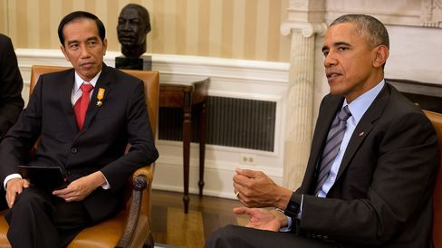 Indonesian President Jokowi Widodo, left, listens as U.S. President Barack Obama speaks during a meeting at the White House Oct. 26.