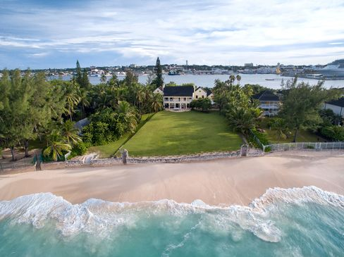 Kilkee House goes on the auction block on Jan. 14, with a reserve price of $10 million. It sits on more than 2acres of property on Paradise Island, with Nassau harbor on one side and expansive lawns and gardens leading to 200 feet of oceanfront on the other.