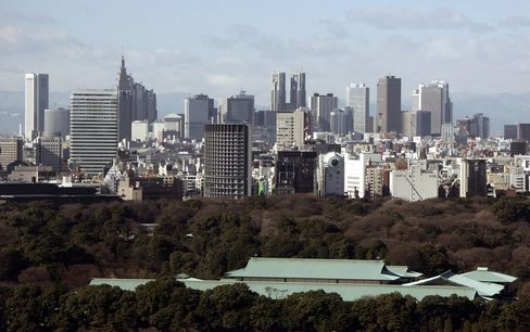 Tokyo's Shinjuku district rises above the forested Imperial Palace grounds and buildings January 16, 2003. Photographer: Rudi van Starrex/Bloomberg News