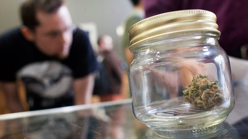 Customers shop for marijuana at Top Shelf Cannabis, a retail store, on July 8, 2014, in Bellingham, Wash.
